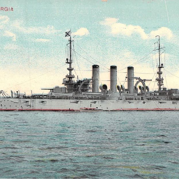 Colored postcard of a battleship in the ocean, against the backdrop of the blue sky. Labeled U.S.S. Georgia